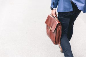 Man carries briefcase to what may be a pointless job